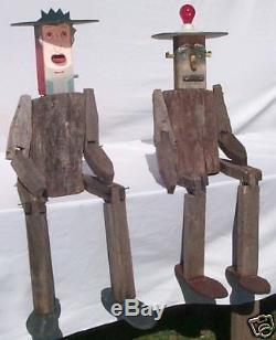 2 large and funky yard art people 1 is also birdhouse