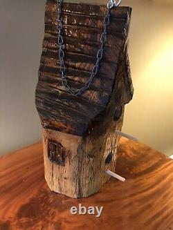 Birdhouse hand carved and stained from 1 single log 17 x 9 8 lbs
