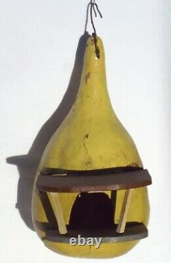 Nicely painted YELLOW Folk Art birdhouse of wood set in a gourd. BROWN ROOF