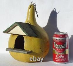 Nicely painted YELLOW Folk Art birdhouse of wood set in a gourd. GREEN ROOF