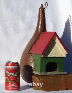 Nicely painted YELLOW Folk Art birdhouse of wood set in a gourd. RED & WT. ROOF