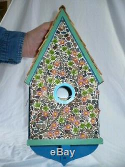 Stone and glass flower chalet birdhouse